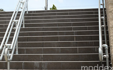 Location of Stairs to Prevent Protrusion of Handrails at Property Boundaries